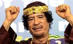 Libya's leader Muammar Gaddafi gestures as he attends the Second Forum for Kings, Sultans, Princes, Sheikhs and Mayors of Africa in Tripoli